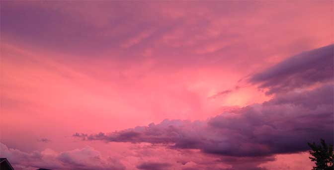 A Missouri sunset of magenta, white and purple clouds, Unaltered image.